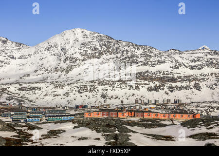 Modern Inuit houses and Ukkusissat (Store Malene) mountain in the background, Nuuk city, Greenland - Stock Photo