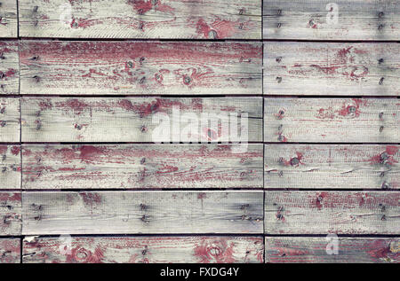 Old wooden planks texture with weathered red paint - Stock Photo