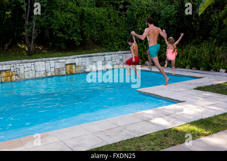 Young Girl Jumping Off Diving Board Into Pool Stock Photo Royalty Free Image 8975425 Alamy