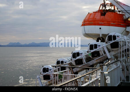 Lifeboat on davits, on the 'MV Isle of Lewis' ferry boat off the northwest coast of Scotland, UK. - Stock Photo
