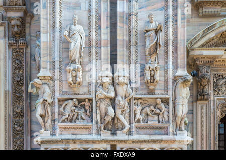 Sculptures on the marble facade, Milan Cathedral, Piazza del Duomo, Milan, Italy - Stock Photo