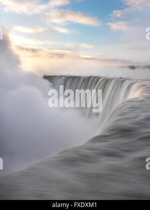 Brink of Niagara Falls, Canadian Falls or Horseshoe Falls, in winter, Niagara Falls, Ontario, Canada - Stock Photo