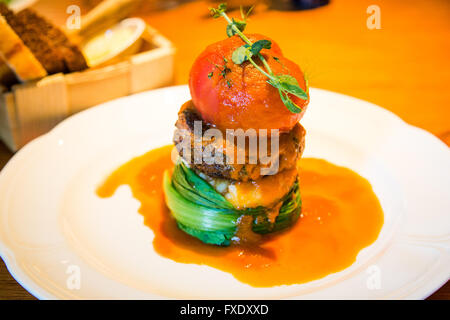 Lamb patty at Sfaar, a trendy restaurant in the Rotermann Quarter, Tallinn, Estonia - Stock Photo
