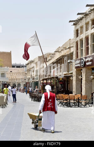 Man with Garette in the Wakif Souk or Souq Waqif, bazar, Doha, Qatar - Stock Photo