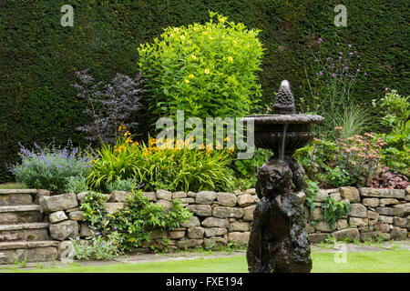 A beautiful, private, traditional, landscaped, country garden, West Yorkshire, England  - ornamental cherub fountain, - Stock Photo