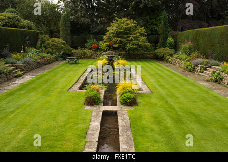 A beautiful, private, traditional, landscaped, country garden, West Yorkshire, England  - ornamental pond, fountain, - Stock Photo