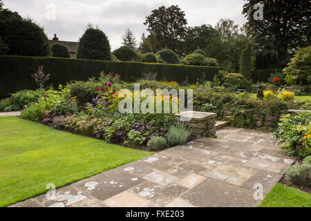 A beautiful, private, traditional, landscaped, country garden, West Yorkshire, England  -  herbaceous border with - Stock Photo