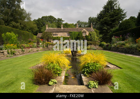 A beautiful, private, traditional, landscaped, country garden, West Yorkshire, England  - ornamental pond, fountain - Stock Photo