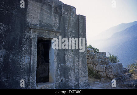 Massive plundered Lycian tomb in the hills of Kas, Antalya, Province, Turkey - Stock Photo