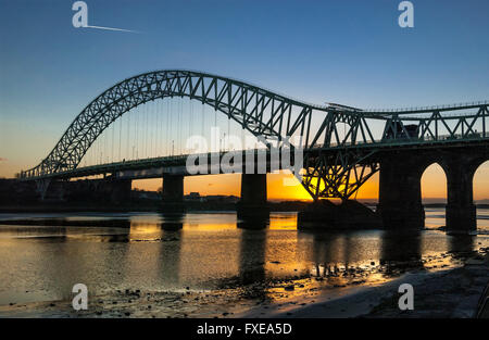 The Queensway bridge over the river Mersey from Widnes to Runcorn. Cheshire North West England. Sunset - Stock Photo