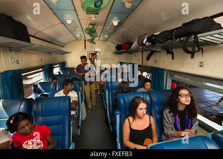 Sri Lanka, train travel, Highland Railway, Nan Oya, passengers in First Class Observation Car - Stock Photo