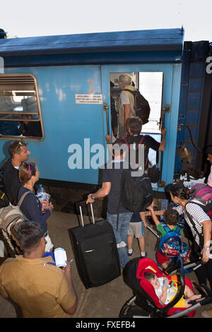 Sri Lanka, train travel, Nan Oya Station, Highland Railway, tourists boarding train - Stock Photo