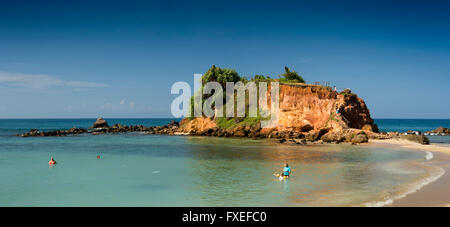 Sri Lanka, Mirissa, mother and daughter relaxing in sea on idyllic tropical beach at Parrot Rock - Stock Photo
