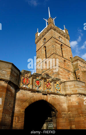 Outer gateway to Linlithgow Palace with the tower of the Church of St Michael, Linlithgow - Stock Photo