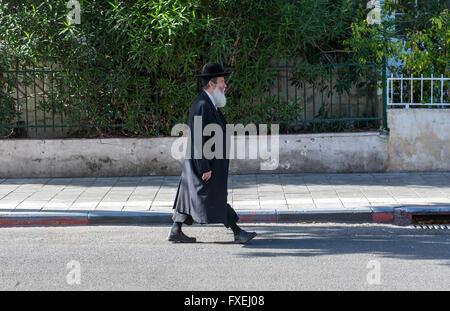 Man walking on street in Tel Aviv city, Israel - Stock Photo