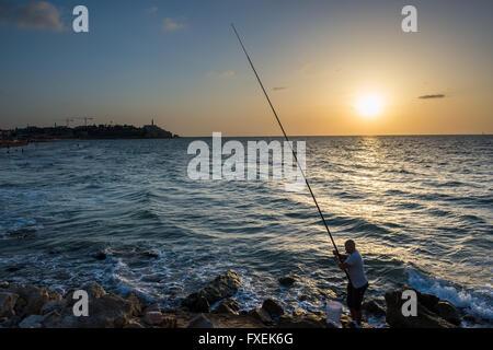 Sunset over Mediterranean Sea seen from the beach in Tel Aviv city, Israel - Stock Photo