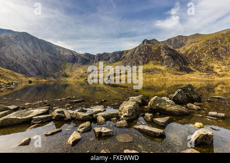 Looking across Llyn Idwal towards Cwm Idwal in the Snowdonia National Park, Wales. - Stock Photo