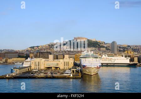 Cruise port terminal Naples, Italy, in early morning with Naples in background. - Stock Photo