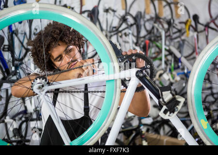Worker repairing bicycles - Stock Photo