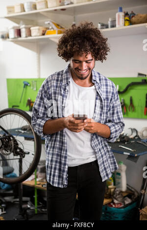 Smiling worker using phone - Stock Photo