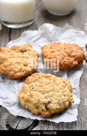 Healthy oats cookies on baking paper, country style - Stock Photo