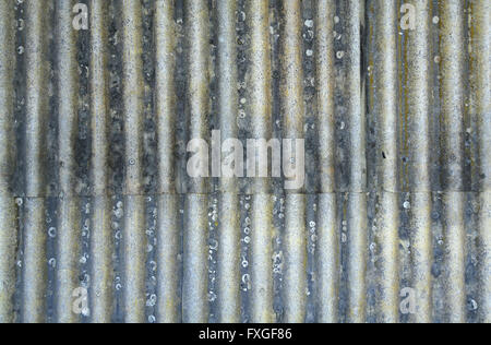 Rusty corrugated metal sheets with rivets - Stock Photo