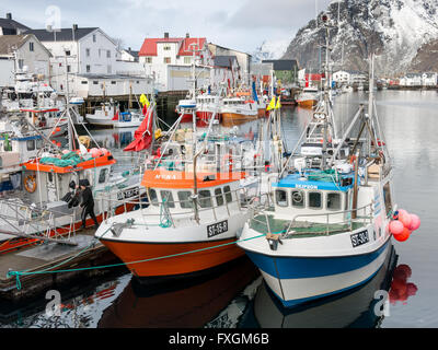 Fishing boats in Henningsvaer harbour on Austvagoy, Lofoten Islands, Norway - Stock Photo