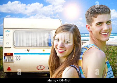 Young couple traveling with camper - Stock Photo