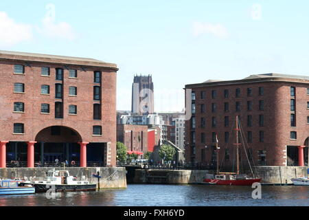 Albert Docks Liverpool, redeveloped as a tourist attraction with boats at the quayside. The Anglican Cathedral in - Stock Photo
