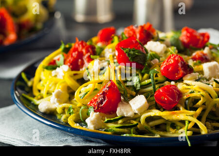 Homemade Zucchini Noodles Zoodles Pasta with Tomatos and Feta - Stock Photo
