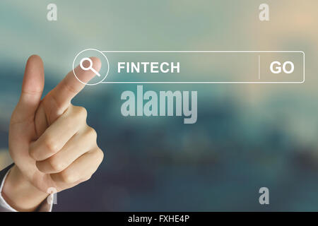 business hand clicking fintech or financial technology button on search toolbar with vintage style effect - Stock Photo