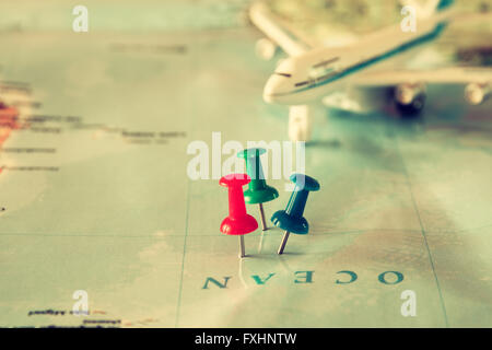 pins attached to map, showing location or travel destination . retro style image. selective focus. - Stock Photo