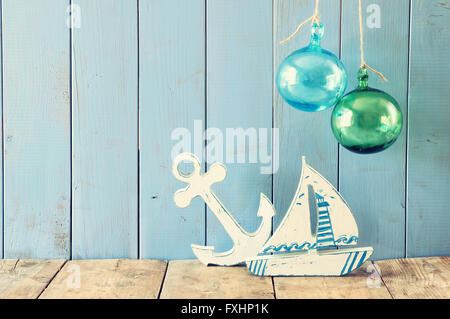 nautical life style objects on wooden table. vintage filtered. - Stock Photo