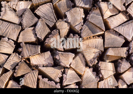 Chopped firewood, stacked and ready for winter. - Stock Photo