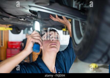 mechanic holding a flashlight stock photo 277205185 alamy