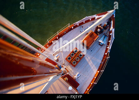 View down from main mast of historic 65 foot sailboat at sunset on Chesapeake Bay; Maryland; USA - Stock Photo