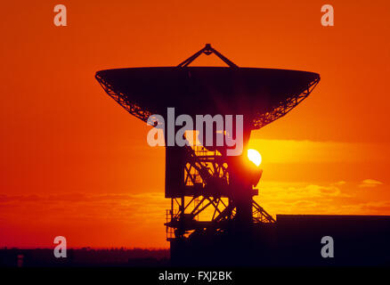 Sunset over telecommunications satellite dish near Cornwall: England - Stock Photo