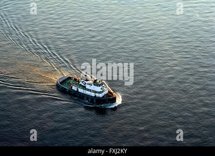 Aerial view of tugboat in Delaware River near Philadelphia; Pennsylvania: USA - Stock Photo