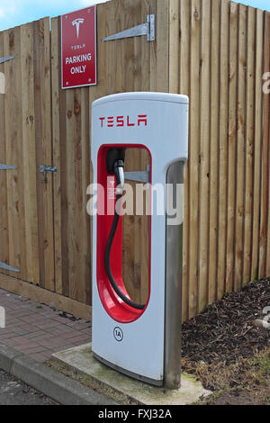 Tesla car charging point at Gretna motorway services in a parking bay for Tesla cars only - Stock Photo
