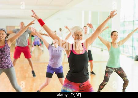 Fitness instructor leading aerobics class - Stock Photo