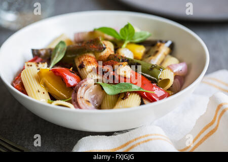 Rigatoni with roasted ,aubergine,bell pepper and garlic - Stock Photo