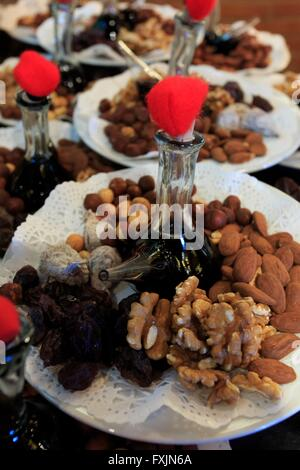Nuts, dates and vinegar at a restaurant beside the Montserrat monastery near Barcelona, Spain - Stock Photo