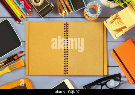 top view photo of blank notebook, old camera and school supplies on wooden table. vintage filtered - Stock Photo