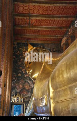 Big Reclining Golden Buddha Statue in Bangkok - Thailand - Stock Photo