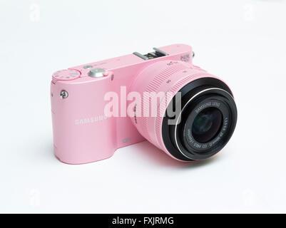 pink Samsung digital camera - Stock Photo