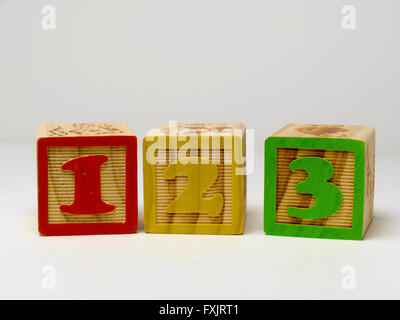 Kid's building blocks spelling the word 123. - Stock Photo