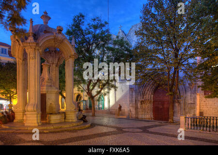 Largo do Carmo square with drinking fountain Chafariz do Carmo in front of Convento do Carmo at dusk, old town Chiado, - Stock Photo