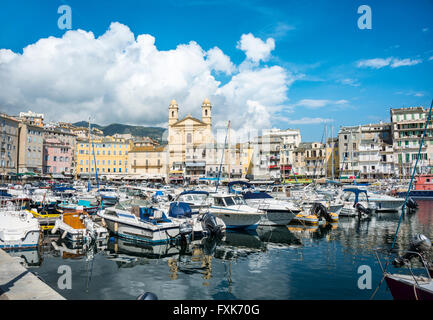 Old port with boats, Vieux port, Port de Plaisance, marina with the church Saint Jean Baptiste, Bastia, Haute-Corse, - Stock Photo