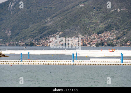 Lake Iseo, Italy. 16th April, 2016. Workers build Christo and Jeanne-Claude's artwork 'The Floating Pier'. Roberto - Stock Photo