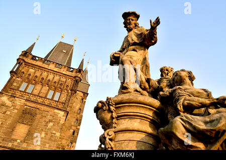 Prague, Czech Republic. Statue of St Ivo on Charles Bridge (Karluv most) by the Old Town Bridge Tower - Stock Photo